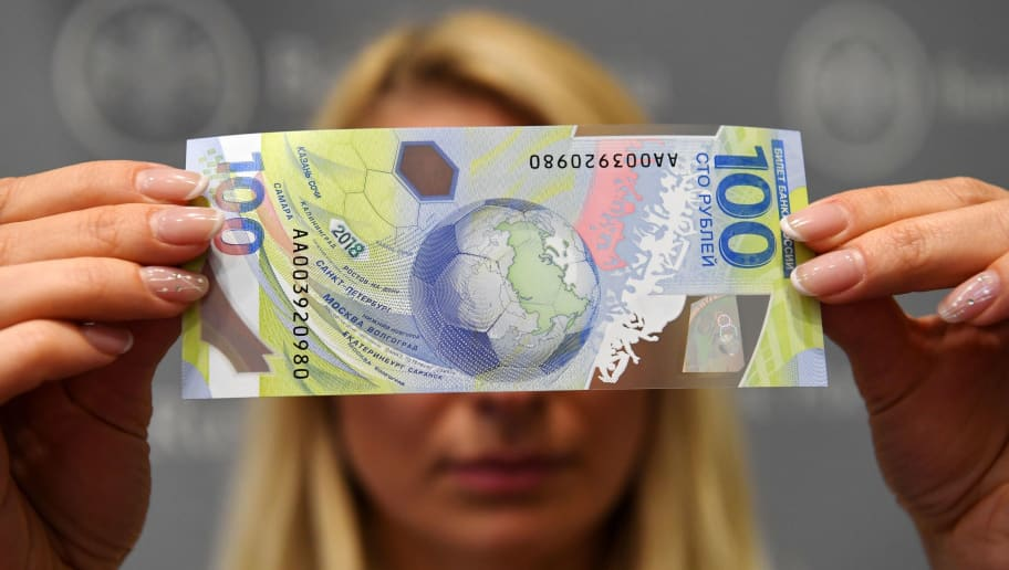 A picture taken on May 22, 2018 shows the commemorative 100-ruble banknote for the 2018 FIFA World Cup football tournament. - Some 20 million polymer banknotes will be put into circulation starting on May 22. (Photo by Kirill KUDRYAVTSEV / AFP)        (Photo credit should read KIRILL KUDRYAVTSEV/AFP/Getty Images)