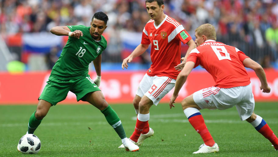 Saudi Arabia's forward Salem Al-Dawsari (L) vies with Russia's midfielder Alan Dzagoev (C) during the Russia 2018 World Cup Group A football match between Russia and Saudi Arabia at the Luzhniki Stadium in Moscow on June 14, 2018. (Photo by Patrik STOLLARZ / AFP) / RESTRICTED TO EDITORIAL USE - NO MOBILE PUSH ALERTS/DOWNLOADS        (Photo credit should read PATRIK STOLLARZ/AFP/Getty Images)