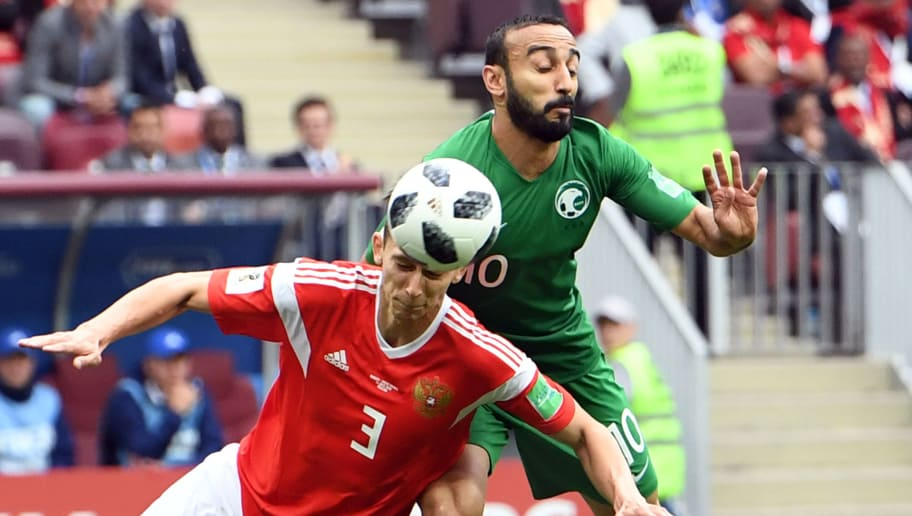 Russia's defender Ilja Kutepov (L) vies with Saudi Arabia's forward Mohammed Al-Sahlawi during the Russia 2018 World Cup Group A football match between Russia and Saudi Arabia at the Luzhniki Stadium in Moscow on June 14, 2018. (Photo by Francisco LEONG / AFP) / RESTRICTED TO EDITORIAL USE - NO MOBILE PUSH ALERTS/DOWNLOADS        (Photo credit should read FRANCISCO LEONG/AFP/Getty Images)
