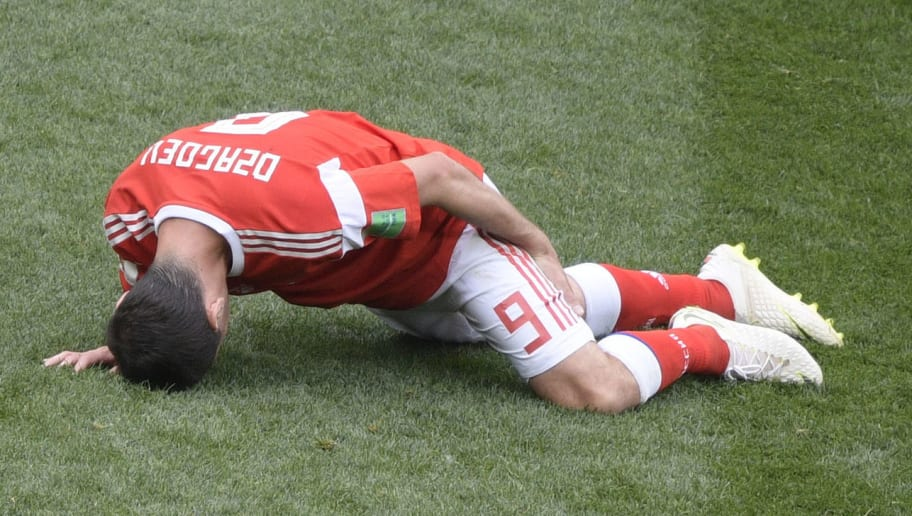Russia's midfielder Alan Dzagoev reacts after injuring himself during the Russia 2018 World Cup Group A football match between Russia and Saudi Arabia at the Luzhniki Stadium in Moscow on June 14, 2018. (Photo by Juan Mabromata / AFP) / RESTRICTED TO EDITORIAL USE - NO MOBILE PUSH ALERTS/DOWNLOADS        (Photo credit should read JUAN MABROMATA/AFP/Getty Images)