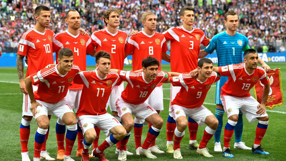 Russia's (Back row, From L) forward Fedor Smolov, defender Sergey Ignashevich, defender Mario Fernandes, midfielder Yuri Gazinskiy and defender Ilja Kutepov (Front row, From L)  midfielder Roman Zobnin, midfielder Aleksandr Golovin,   midfielder Yury Zhirkov, midfielder Alan Dzagoev and midfielder Alexander Samedov pose for the team photo prior to  the Russia 2018 World Cup Group A football match between Russia and Saudi Arabia at the Luzhniki Stadium in Moscow on June 14, 2018. (Photo by Alexander NEMENOV / AFP) / RESTRICTED TO EDITORIAL USE - NO MOBILE PUSH ALERTS/DOWNLOADS        (Photo credit should read ALEXANDER NEMENOV/AFP/Getty Images)