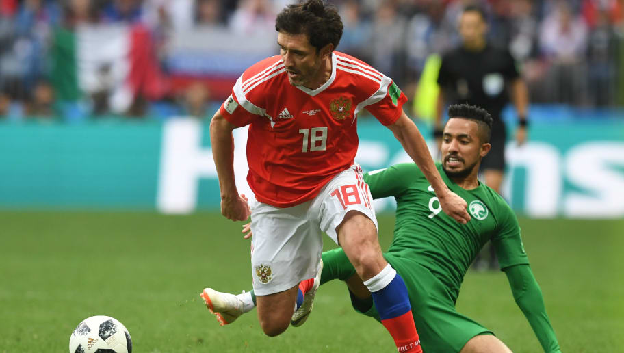 Russia's midfielder Yury Zhirkov (L) vies with Saudi Arabia's midfielder Hatan Babhir during the Russia 2018 World Cup Group A football match between Russia and Saudi Arabia at the Luzhniki Stadium in Moscow on June 14, 2018. (Photo by Francisco LEONG / AFP) / RESTRICTED TO EDITORIAL USE - NO MOBILE PUSH ALERTS/DOWNLOADS        (Photo credit should read FRANCISCO LEONG/AFP/Getty Images)