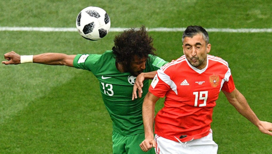 Saudi Arabia's defender Yasser Al-Shahrani (L) and Russia's midfielder Alexander Samedov compete for the ball during the Russia 2018 World Cup Group A football match between Russia and Saudi Arabia at the Luzhniki Stadium in Moscow on June 14, 2018. (Photo by Mladen ANTONOV / AFP) / RESTRICTED TO EDITORIAL USE - NO MOBILE PUSH ALERTS/DOWNLOADS        (Photo credit should read MLADEN ANTONOV/AFP/Getty Images)