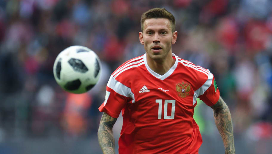 Russia's forward Fedor Smolov eyes the ball during the Russia 2018 World Cup Group A football match between Russia and Saudi Arabia at the Luzhniki Stadium in Moscow on June 14, 2018. (Photo by Patrik STOLLARZ / AFP) / RESTRICTED TO EDITORIAL USE - NO MOBILE PUSH ALERTS/DOWNLOADS        (Photo credit should read PATRIK STOLLARZ/AFP/Getty Images)