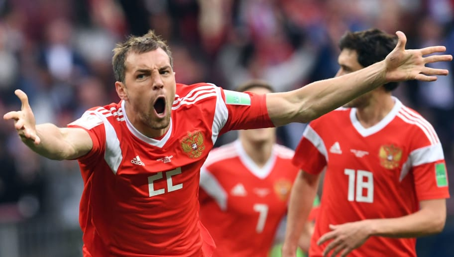 Russia's forward Artem Dzyuba celebrates after scoring their third goal during the Russia 2018 World Cup Group A football match between Russia and Saudi Arabia at the Luzhniki Stadium in Moscow on June 14, 2018. (Photo by Francisco LEONG / AFP) / RESTRICTED TO EDITORIAL USE - NO MOBILE PUSH ALERTS/DOWNLOADS        (Photo credit should read FRANCISCO LEONG/AFP/Getty Images)