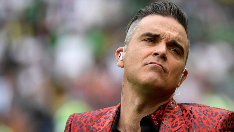 English singer Robbie Williams performs during the opening ceremony  before the Russia 2018 World Cup Group A football match between Russia and Saudi Arabia at the Luzhniki Stadium in Moscow on June 14, 2018. (Photo by Alexander NEMENOV / AFP) / RESTRICTED TO EDITORIAL USE - NO MOBILE PUSH ALERTS/DOWNLOADS        (Photo credit should read ALEXANDER NEMENOV/AFP/Getty Images)
