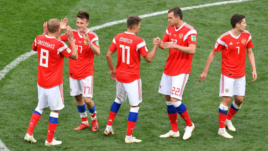 (L-R) Russia's midfielder Yuri Gazinskiy, Russia's midfielder Aleksandr Golovin, Russia's midfielder Roman Zobnin, Russia's forward Artem Dzyuba and Russia's midfielder Daler Kuzyaev celebrate during the Russia 2018 World Cup Group A football match between Russia and Saudi Arabia at the Luzhniki Stadium in Moscow on June 14, 2018. (Photo by Mladen ANTONOV / AFP) / RESTRICTED TO EDITORIAL USE - NO MOBILE PUSH ALERTS/DOWNLOADS        (Photo credit should read MLADEN ANTONOV/AFP/Getty Images)