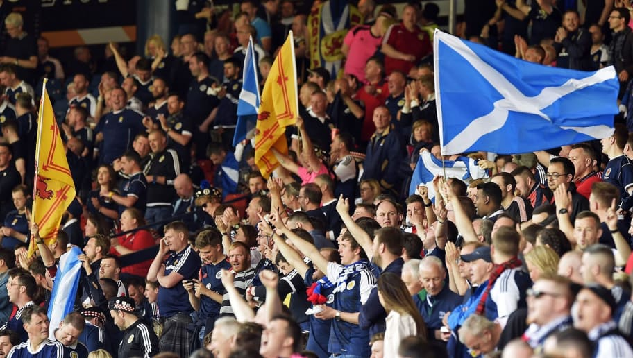 Scotland supporters wave flags in the crowd ahead of the group F World Cup qualifying football match between Scotland and England at Hampden Park in Glasgow on June 10, 2017. / AFP PHOTO / ANDY BUCHANAN / NOT FOR MARKETING OR ADVERTISING USE / RESTRICTED TO EDITORIAL USE         (Photo credit should read ANDY BUCHANAN/AFP/Getty Images)