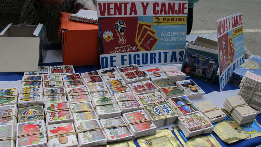 A street vendor, sales and exchanges Panini World Cup football stickers at a stall on Montevideo's main avenue on May 16, 2018. (Photo by MIGUEL ROJO / AFP)        (Photo credit should read MIGUEL ROJO/AFP/Getty Images)