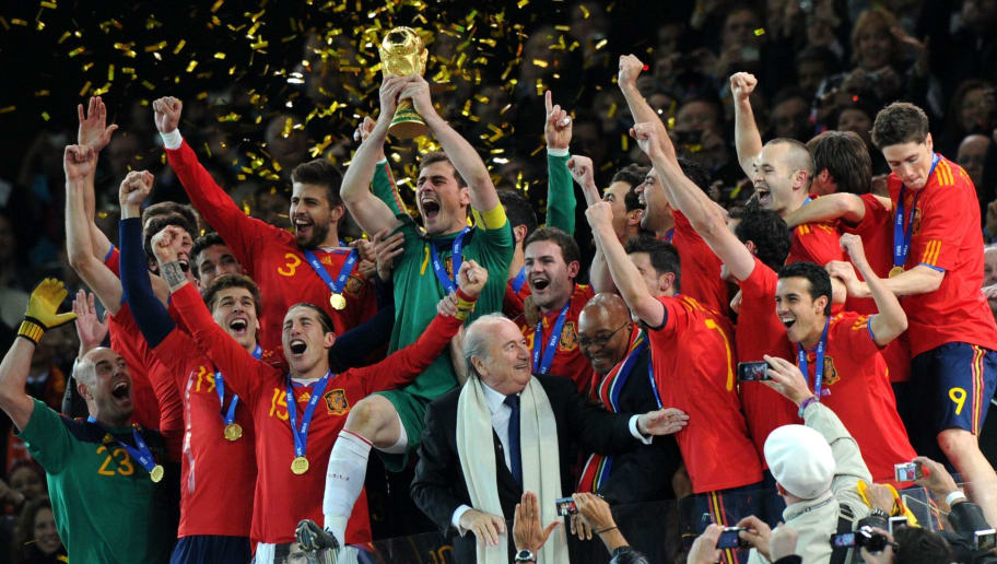 Spain's national football team players celebrate with the trophy during the award ceremony following the 2010 World Cup football final Netherlands vs. Spain on July 11, 2010 at Soccer City stadium in Soweto, suburban Johannesburg. NO PUSH TO MOBILE / MOBILE USE SOLELY WITHIN EDITORIAL ARTICLE - AFP PHOTO / PEDRO UGARTE / AFP PHOTO / PEDRO UGARTE        (Photo credit should read PEDRO UGARTE/AFP/Getty Images)