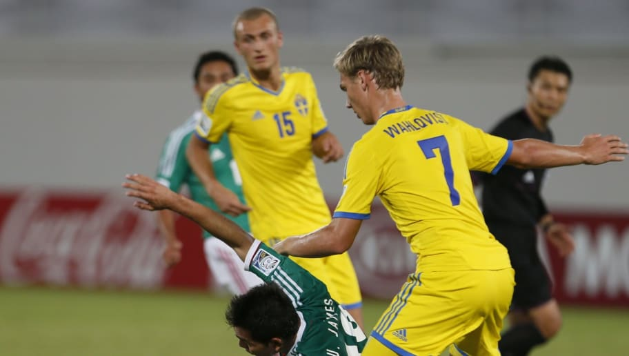 Sweden's Linus Wahlqvist (R) ies with Mexico's Ulises Jaimes (L) during their FIFA U-17 World Cup UAE 2013 football match Sweden versus Mexico at the Sheikh Khalifa International Stadium in al-Ain on October 25, 2013. AFP PHOTO / KARIM SAHIB        (Photo credit should read KARIM SAHIB/AFP/Getty Images)
