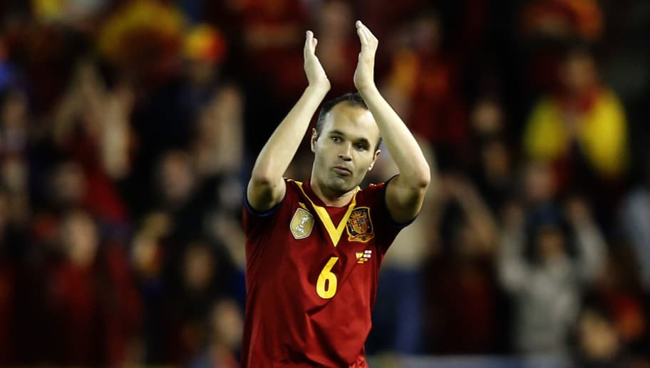 Spain's midfielder Andres Iniesta gestures as he leaves the pitch during the World Cup 2014 qualifying football match Spain vs Georgia at the Carlos del Monte stadium in Albacete on October 15, 2013. Spain won the match 2-0.  AFP PHOTO / JOSE JORDAN        (Photo credit should read JOSE JORDAN/AFP/Getty Images)