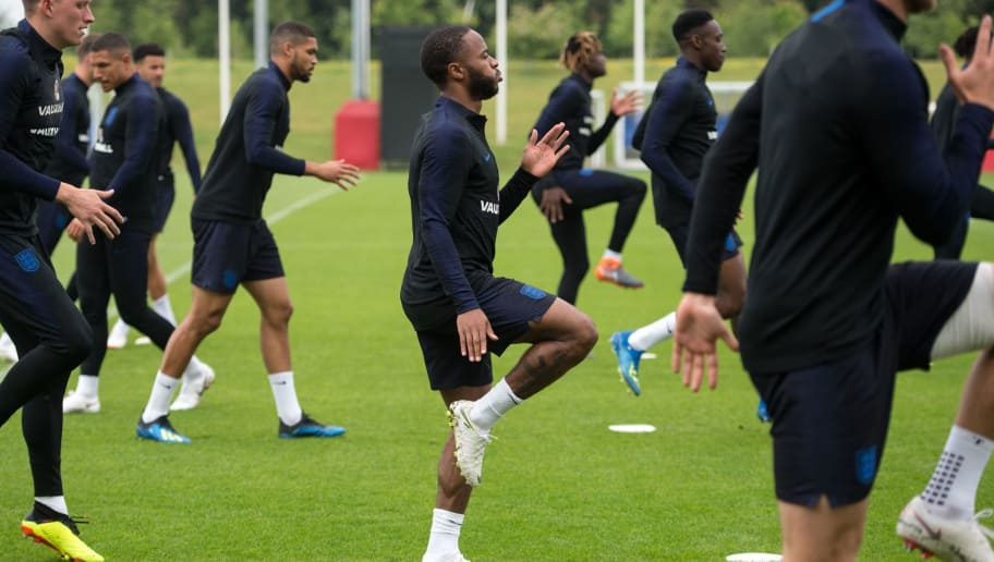 England's midfielder Raheem Sterling takes part in a training session at St George's Park in Burton-on-Trent on May 28, 2018, ahead of their international friendly football matches against Nigeria and Costa Rica. (Photo by OLI SCARFF / AFP) / NOT FOR MARKETING OR ADVERTISING USE / RESTRICTED TO EDITORIAL USE        (Photo credit should read OLI SCARFF/AFP/Getty Images)