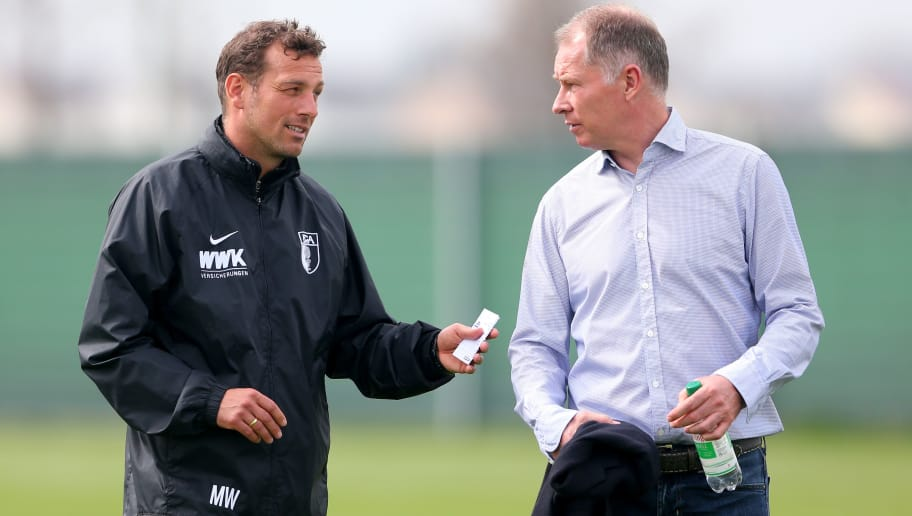 AUGSBURG, BAVARIA - APRIL 05:  Markus Weinzierl, head coach of Augsburg talks to Stefan Reuter (R), Sporting director of Augsburg after a FC Augsburg Training session at WWK Arena  on April 5, 2016 in Augsburg, Germany.  (Photo by Alexander Hassenstein/Bongarts/Getty Images)