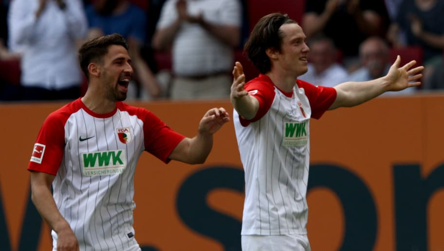 AUGSBURG, GERMANY - APRIL 22:  Michael Gregoritsch (R) of Augsburg celebrates after he scores the opening goal during the Bundesliga match between FC Augsburg and 1. FSV Mainz 05 at WWK-Arena on April 22, 2018 in Augsburg, Germany.  (Photo by Adam Pretty/Bongarts/Getty Images)