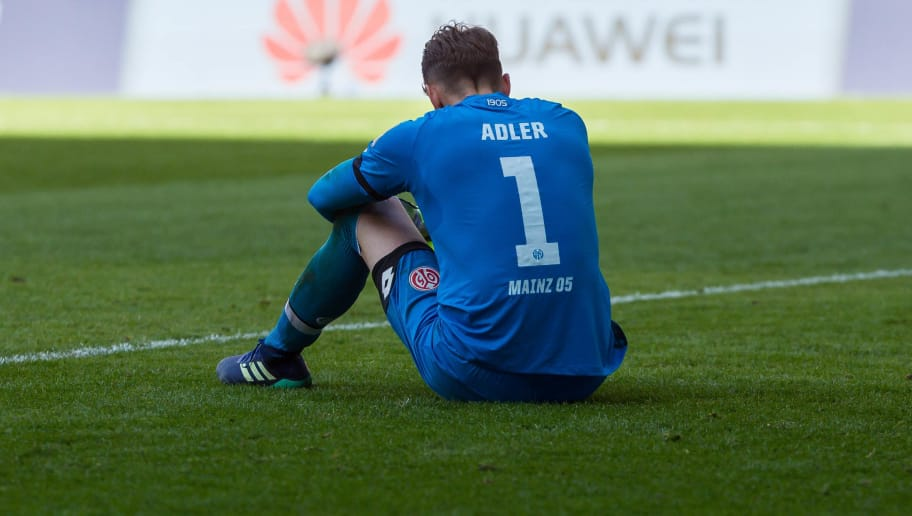 AUGSBURG, GERMANY - APRIL 22: Goalkeeper Rene Adler of Mainz looks dejected during the Bundesliga match between FC Augsburg and 1. FSV Mainz 05 at WWK-Arena on April 22, 2018 in Augsburg, Germany. (Photo by TF-Images/TF-Images via Getty Images)