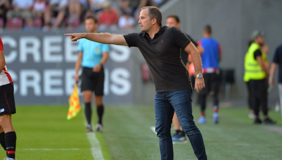 AUGSBURG, GERMANY - AUGUST 12: Head coach Manuel Baum of FC Augsburg gestures during the friendly match between FC Augsburg and Athletic Club Bilbao on August 12, 2018 in Augsburg, Germany. (Photo by TF-Images/Getty Images)