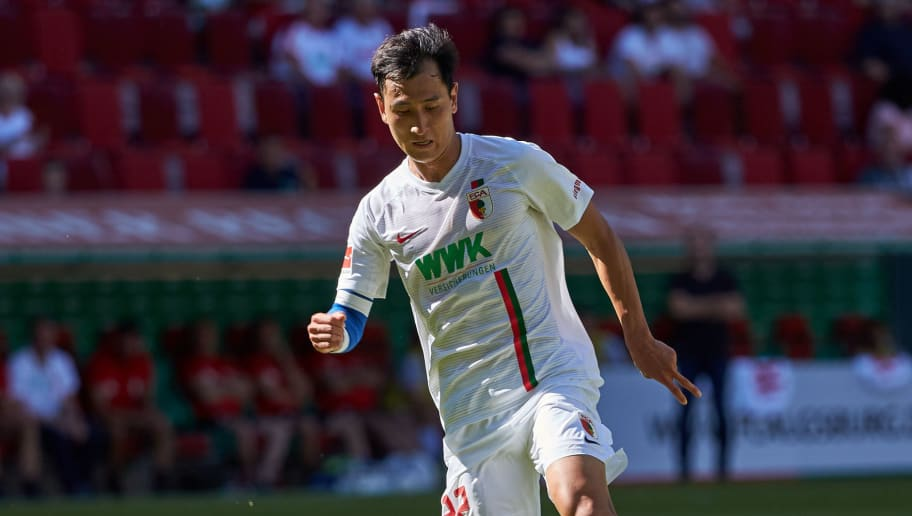 AUGSBURG, GERMANY - AUGUST 12: Dong-Won Ji of FC Augsburg controls the ball during the friendly match between FC Augsburg and Athletic Club Bilbao on August 12, 2018 in Augsburg, Germany. (Photo by TF-Images/Getty Images)