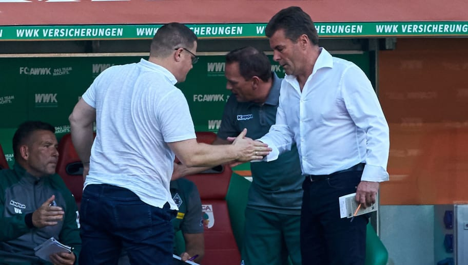 AUGSBURG, GERMANY - AUGUST 26: Sportdirektor Max Eberl of Moenchengladbach shakes hands with Head coach Dieter Hecking of Moenchengladbach during a Bundesliga match between FC Augsburg and Borussia Moenchengladbach at WWK Arena on August 26, 2017 in Moenchengladbach, Germany. (Photo by TF-Images/TF-Images via Getty Images)