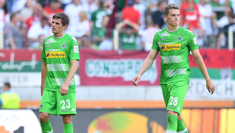 AUGSBURG, GERMANY - AUGUST 26: Jonas Hofmann of Moenchengladbach (l) and Matthias Ginter of Moenchengladbach dejected after the Bundesliga match between FC Augsburg and Borussia Moenchengladbach at WWK-Arena on August 26, 2017 in Augsburg, Germany. (Photo by Sebastian Widmann/Bongarts/Getty Images)