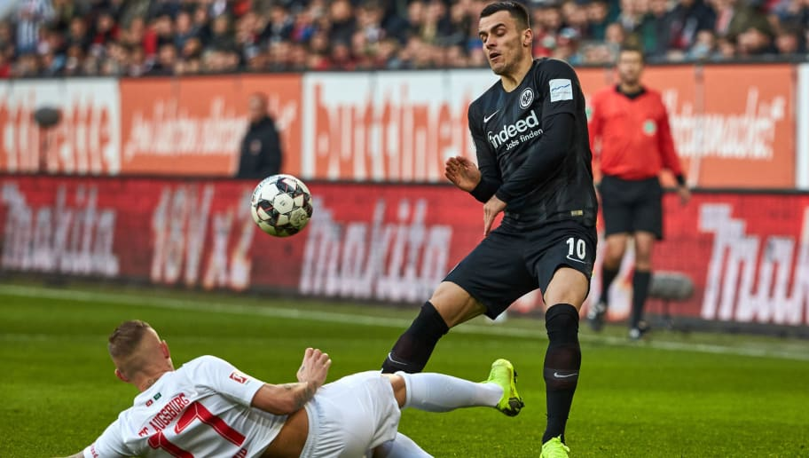 AUGSBURG, GERMANY - NOVEMBER 24: Jonathan Schmid of Augsburg and Filip Kostic of Frankfurt battle for the ball during the Bundesliga match between FC Augsburg and Eintracht Frankfurt at WWK-Arena on November 24, 2018 in Augsburg, Germany. (Photo by TF-Images/Getty Images)
