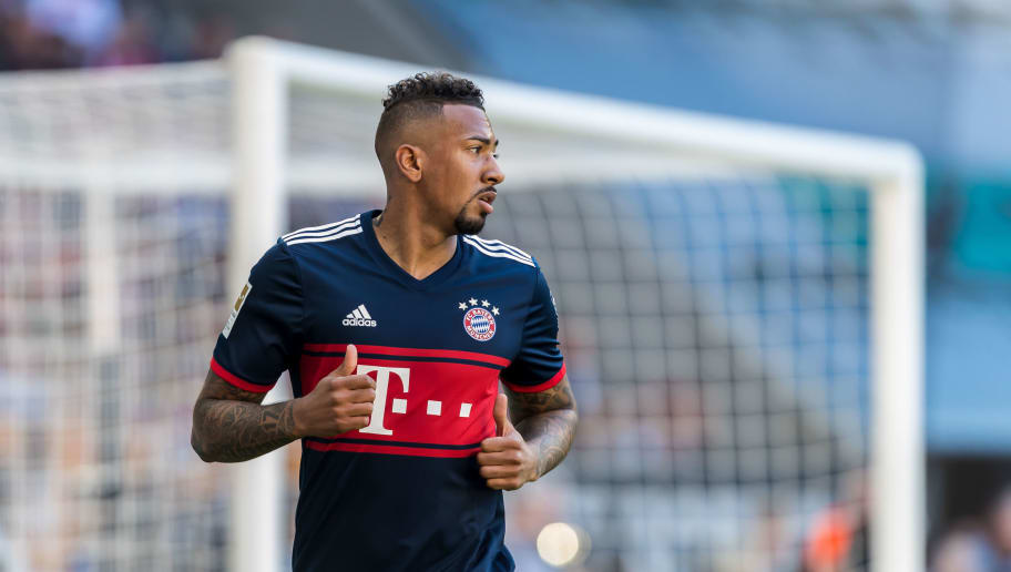 AUGSBURG, GERMANY - APRIL 07: Jerome Boateng of Muenchen looks on during the Bundesliga match between FC Augsburg and FC Bayern Muenchen at WWK-Arena on April 7, 2018 in Augsburg, Germany. (Photo by TF-Images/Getty Images)