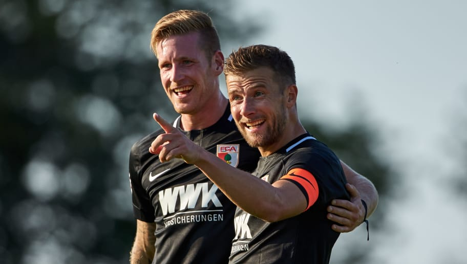 AUGSBURG, GERMANY - JULY 18: Daniel Baier of Augsburg celebrates after scoring his team`s first goal with Andre Hahn of Augsburg during the Friendly match between FC Augsburg and FC Middlesbrough on July 18, 2018 in Augsburg, Germany. (Photo by TF-Images/Getty Images)