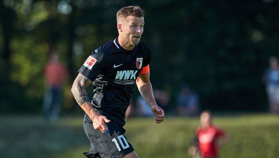 AUGSBURG, GERMANY - JULY 18: Daniel Baier of Augsburg controls the ball during the Friendly match between FC Augsburg and FC Middlesbrough on July 18, 2018 in Augsburg, Germany. (Photo by TF-Images/Getty Images)
