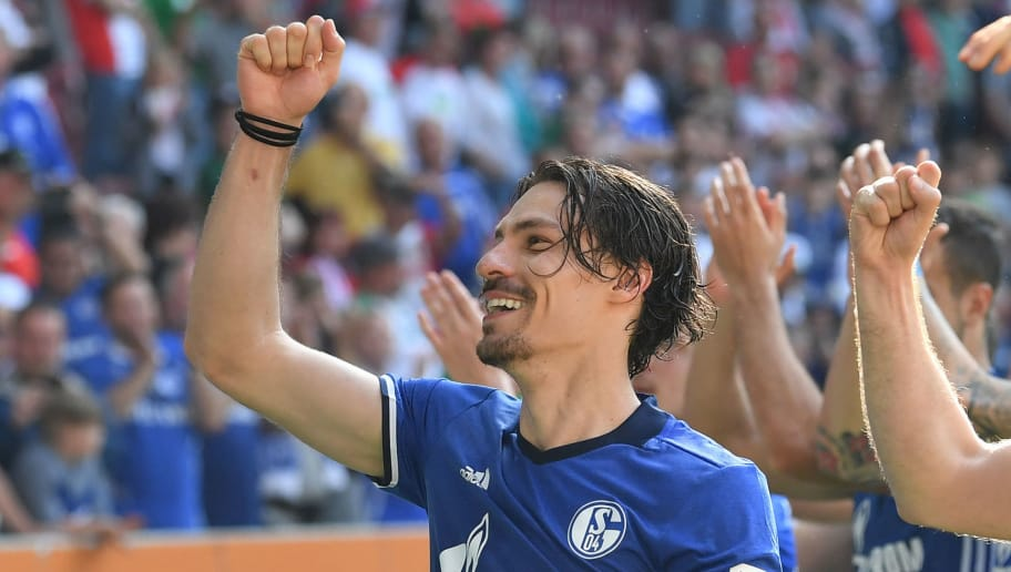 AUGSBURG, GERMANY - MAY 05: Benjamin Stambouli of Schalke celebrates with teammates after the Bundesliga match between FC Augsburg and FC Schalke 04 at WWK-Arena on May 5, 2018 in Augsburg, Germany. (Photo by Sebastian Widmann/Bongarts/Getty Images)