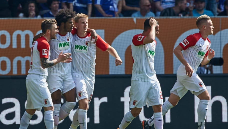 AUGSBURG, GERMANY - MAY 05: Philipp Max of Augsburg celebrates after scoring his team`s first goal with Daniel Baier of Augsburg, Francisco da Silva Caiuby of Augsburg, Martin Hinteregger of Augsburg and Marco Richter of Augsburg during the Bundesliga match between FC Augsburg and FC Schalke 04 at WWK-Arena on May 5, 2018 in Augsburg, Germany. (Photo by TF-Images/Getty Images)