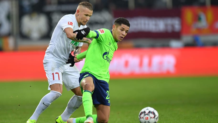 AUGSBURG, GERMANY - DECEMBER 15: Jonathan Schmid of Augsburg and Amine Harit of Schalke compete for the ball during the Bundesliga match between FC Augsburg and FC Schalke 04 at WWK-Arena on December 15, 2018 in Augsburg, Germany. (Photo by Sebastian Widmann/Bongarts/Getty Images)