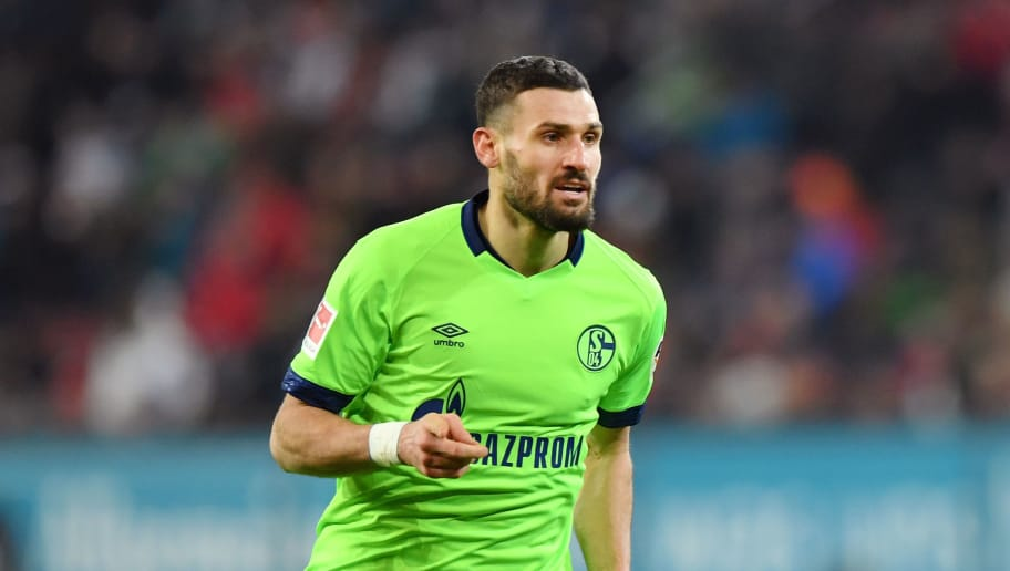 AUGSBURG, GERMANY - DECEMBER 15:  Daniel Caligiuri of FC Schalke 04 celebrates after scoring his team's first goal during the Bundesliga match between FC Augsburg and FC Schalke 04 at WWK-Arena on December 15, 2018 in Augsburg, Germany.  (Photo by Sebastian Widmann/Bongarts/Getty Images)