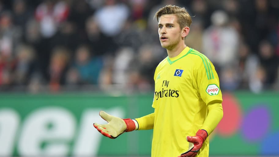 AUGSBURG, GERMANY - JANUARY 13: Goalkeeper Julian Pollersbeck of Hamburg gestures during the Bundesliga match between FC Augsburg and Hamburger SV at WWK-Arena on January 13, 2018 in Augsburg, Germany. (Photo by Sebastian Widmann/Bongarts/Getty Images)
