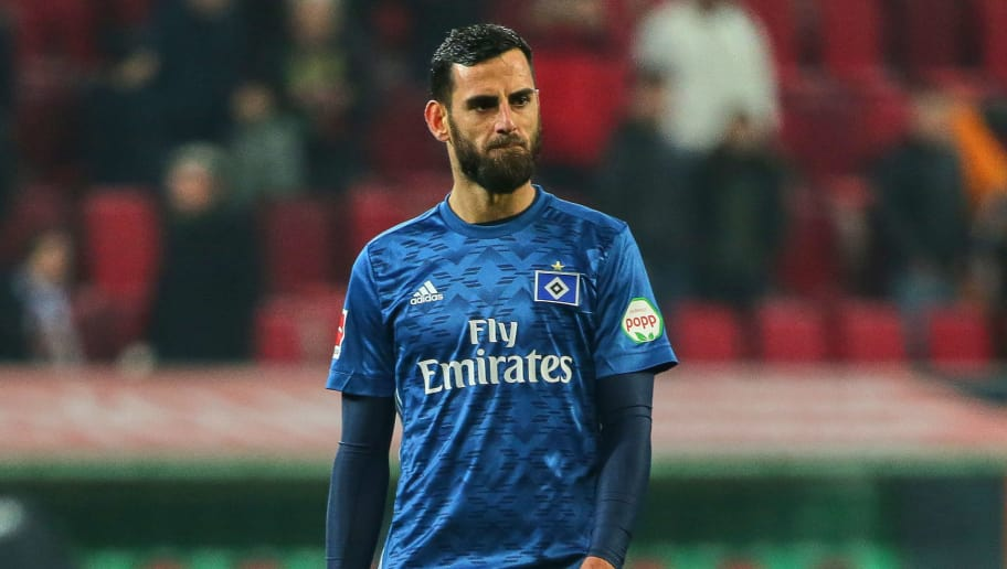 AUGSBURG, GERMANY - JANUARY 13: Mergim Mavraj of Hamburg looks dejected during the Bundesliga match between FC Augsburg and Hamburger SV at WWK-Arena on January 13, 2018 in Augsburg, Germany. (Photo by TF-Images/TF-Images via Getty Images)