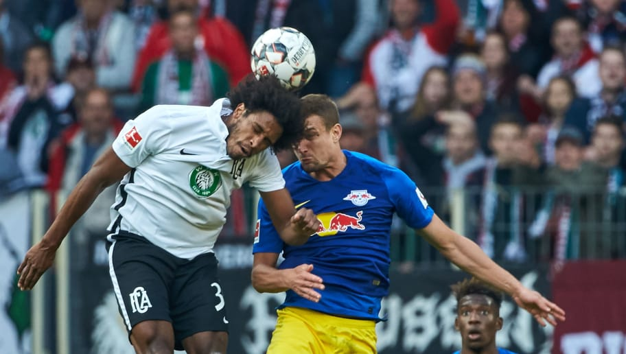 AUGSBURG, GERMANY - OCTOBER 20: Francisco da Silva Caiuby of FC Augsburg and Stefan Ilsanker of RB Leipzig battle for the ball during the Bundesliga match between FC Augsburg and RB Leipzig at WWK-Arena on October 20, 2018 in Augsburg, Germany. (Photo by TF-Images/Getty Images)