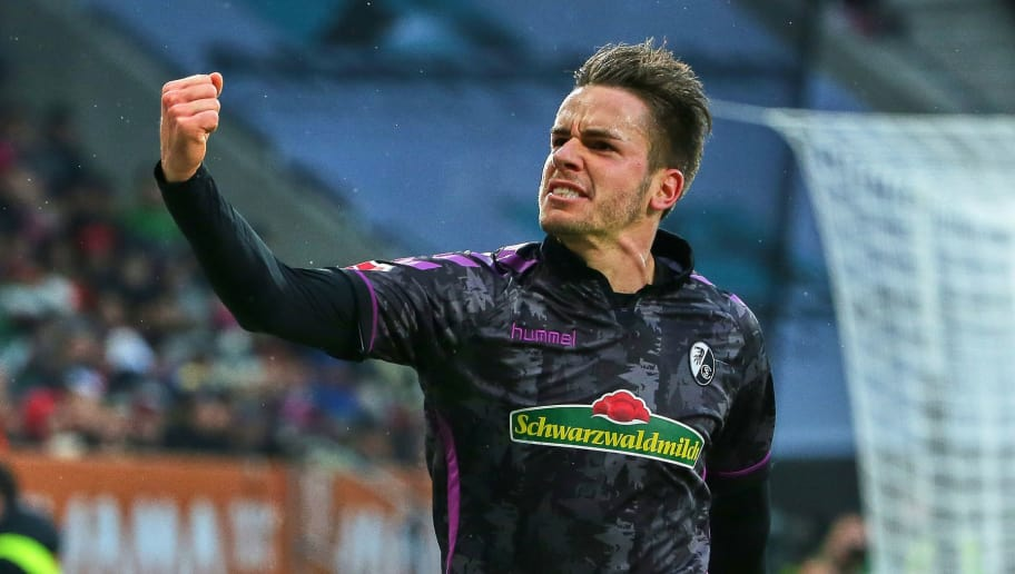 AUGSBURG, GERMANY - DECEMBER 16: Christian Guenter of Freiburg celebrates after scoring his team`s first goal during the Bundesliga match between FC Augsburg and Sport-Club Freiburg at WWK-Arena on December 16, 2017 in Augsburg, Germany. (Photo by TF-Images/TF-Images via Getty Images)