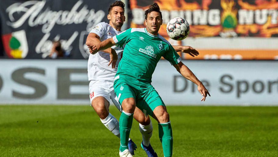 AUGSBURG, GERMANY - SEPTEMBER 22: Rani Khedira of FC Augsburg and Claudio Pizarro of Werder Bremen battle for the ball during the Bundesliga match between FC Augsburg and SV Werder Bremen at WWK-Arena on September 22, 2018 in Augsburg, Germany. (Photo by TF-Images/Getty Images)