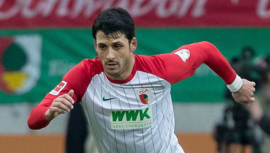AUGSBURG, GERMANY - MARCH 17: Gojko Kacar of Augsburg controls the ball during the Bundesliga match between FC Augsburg and SV Werder Bremen at WWK-Arena on March 17, 2018 in Augsburg, Germany. (Photo by TF-Images/Getty Images)
