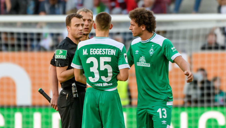 AUGSBURG, GERMANY - SEPTEMBER 22: Referee Felix Zwayer speaks with Maximilian Eggestein of Werder Bremen and Milos Veljkovic of Werder Bremen during the Bundesliga match between FC Augsburg and SV Werder Bremen at WWK-Arena on September 22, 2018 in Augsburg, Germany. (Photo by TF-Images/Getty Images)