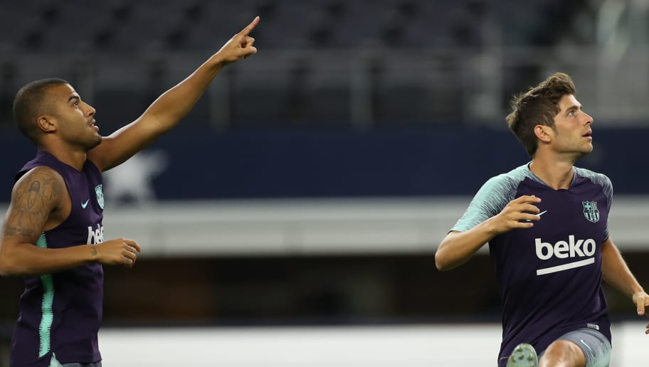 ARLINGTON, TX - JULY 30: Rafinha and Sergi Roberto of Barcelona look on during training session at AT&T Stadium on July 30, 2018 in Arlington, Texas. Barcelona will face AS Roma on July 31st as part of the International Champions Cup 2018. (Photo by Omar Vega/Getty Images)