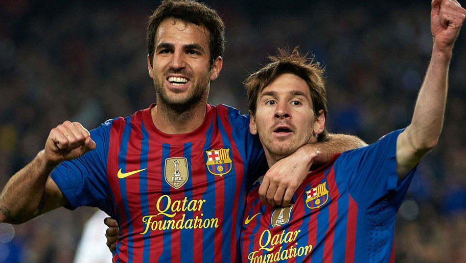 BARCELONA, SPAIN - APRIL 03:  Lionel Messi (R) of Barcelona celebrates with team-mate Cesc Fabregas after scoring the opening goal during the UEFA Champions League quarter-final second leg match between FC Barcelona and AC Milan at the Camp Nou stadium on April 3, 2012 in Barcelona, Spain.  (Photo by Manuel Queimadelos Alonso/Getty Images)
