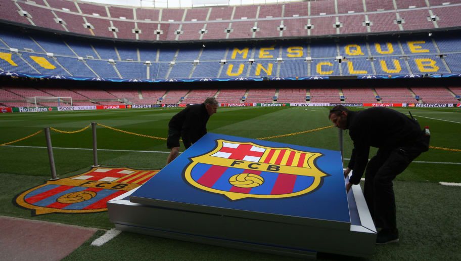 BARCELONA, SPAIN - MARCH 16:  Staff carry a giant Barcelona crest across the pitch before the UEFA Champions League match between FC Barcelona and Arsenal at Camp Nou on March 16, 2016 in Barcelona, Spain.  (Photo by Catherine Ivill - AMA/Getty Images)