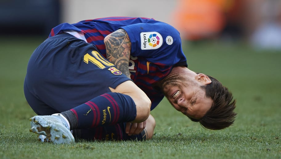 BARCELONA, SPAIN - SEPTEMBER 29:  Lionel Messi of Barcelona lies on the pitch after an injury during the La Liga match between FC Barcelona and Athletic Club at Camp Nou on September 29, 2018 in Barcelona, Spain.  (Photo by Quality Sport Images/Getty Images)