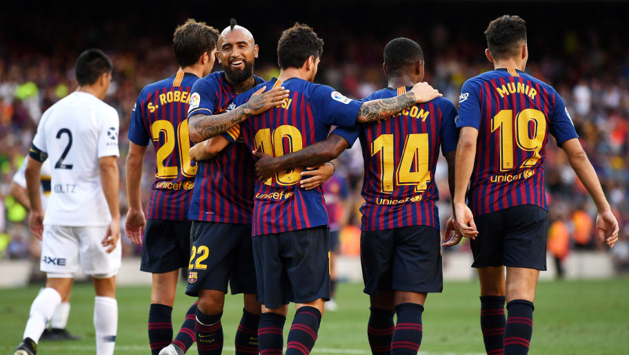 BARCELONA, SPAIN - AUGUST 15:  Lionel Messi of Barcelona (L) celebrates with teammates after scoring his team's second goal during the Joan Gamper Trophy between FC Barcelona and Boca Juniors at Camp Nou on August 15, 2018 in Barcelona, Spain.  (Photo by David Ramos/Getty Images)