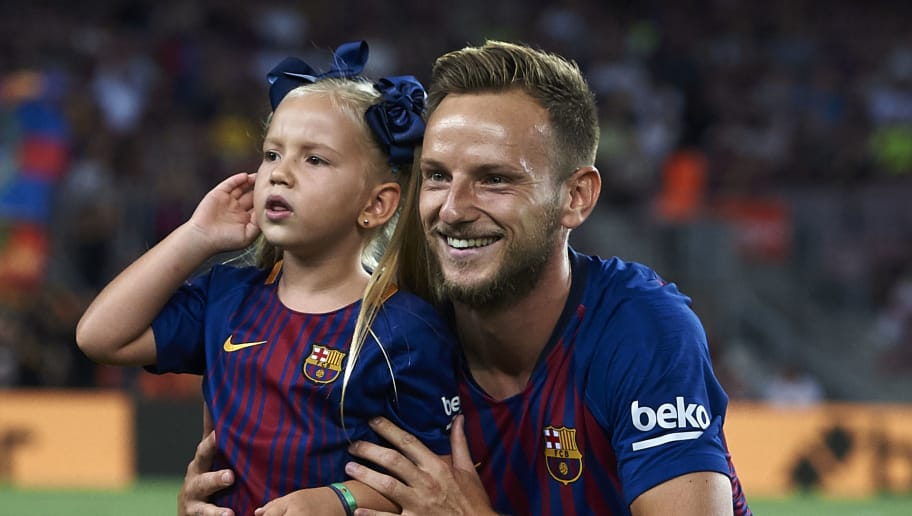 BARCELONA, SPAIN - AUGUST 18:  Ivan Rakitic of Barcelona poses with his child for a photo prior the La Liga match between FC Barcelona and Deportivo Alaves at Camp Nou on August 18, 2018 in Barcelona, Spain.  (Photo by Quality Sport Images/Getty Images)