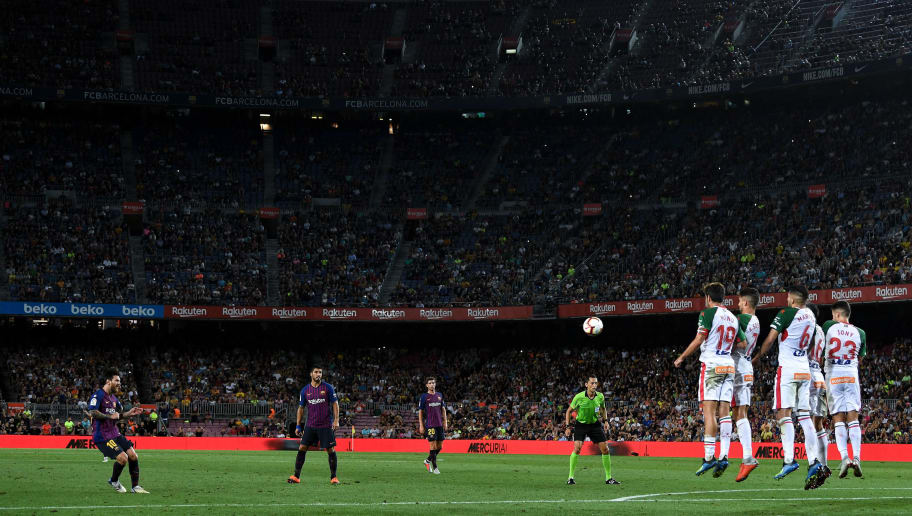 BARCELONA, SPAIN - AUGUST 18:  Lionel Messi of FC Barcelona takes a free kick during the La Liga match between FC Barcelona and Deportivo Alaves at Camp Nou on August 18, 2018 in Barcelona, Spain.  (Photo by David Ramos/Getty Images)