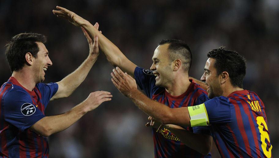 Andres Iniesta,Xavi Hernandez,Lionel Messi