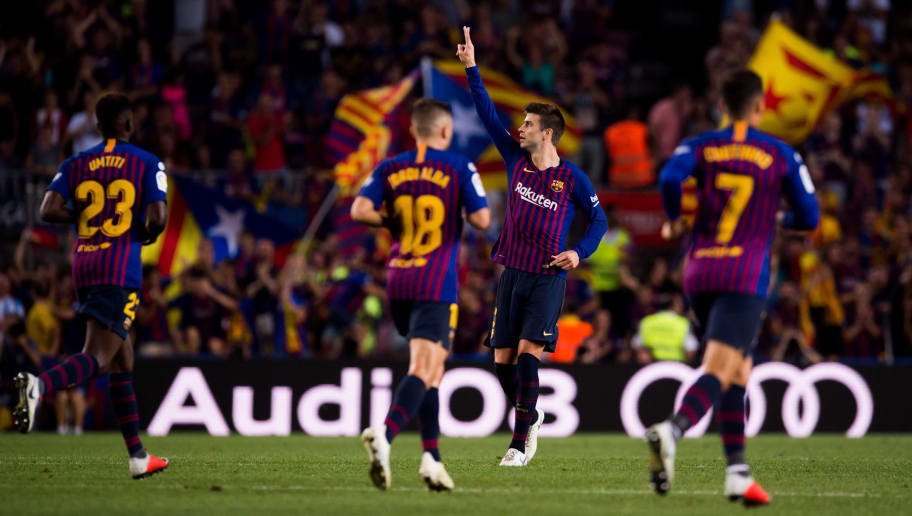 BARCELONA, SPAIN - SEPTEMBER 23:  Gerard Pique of FC Barcelona celebrates after scoring his sides second goal during the La Liga match between FC Barcelona and Girona FC at Camp Nou on September 23, 2018 in Barcelona, Spain.  (Photo by Alex Caparros/Getty Images)