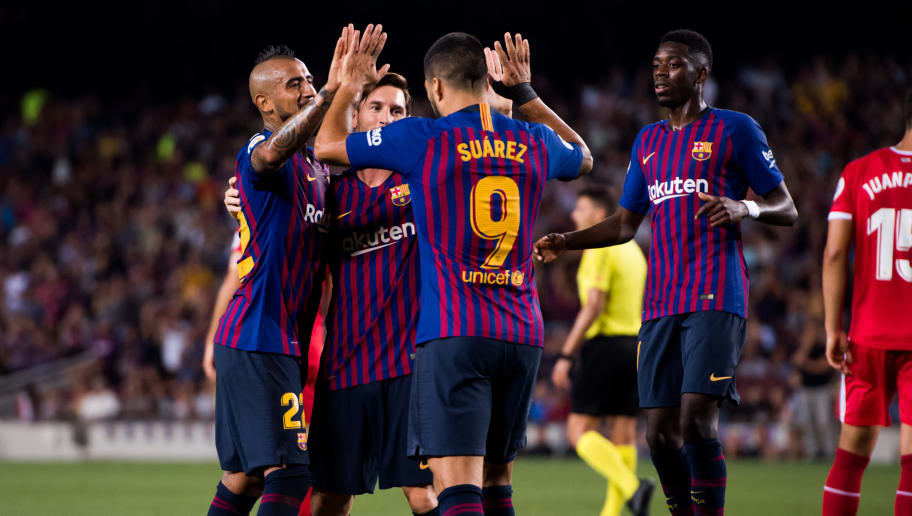BARCELONA, SPAIN - SEPTEMBER 23: Lionel Messi of FC Barcelona celebrates with his teammates Arturo Vidal (L), Luis Suarez (2nd R) and Ousmane Dembele (R) after scoring the opening goal during the La Liga match between FC Barcelona and Girona FC at Camp Nou on September 23, 2018 in Barcelona, Spain. (Photo by Alex Caparros/Getty Images)