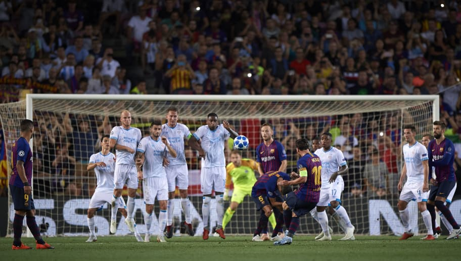 BARCELONA, SPAIN - SEPTEMBER 18:  Lionel Messi (C) of Barcelona takes a free kick during the Group B match of the UEFA Champions League between FC Barcelona and PSV at Camp Nou on September 18, 2018 in Barcelona, Spain.  (Photo by Quality Sport Images/Getty Images)